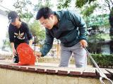 秦皇岛市万名志愿者共同清洗港城扮靓城市容颜