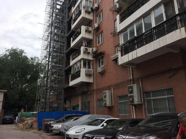 居民不知如何给老旧小区装电梯,上海这个街道提供陪伴式辅导